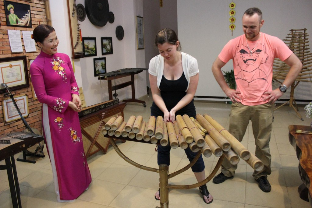 Courtney tries her hand at playing the Ðàn Klôngpút, a rare instrument from the mountains of Vietnam