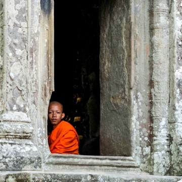 Monk in window of Angkor Wat