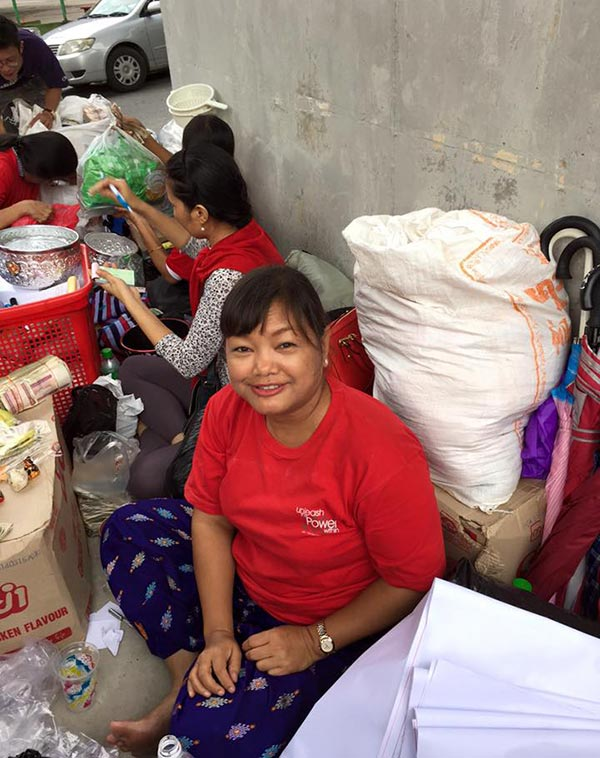 Journeys Within Myanmar Country Director Dar Le Khin helping organize relief supplies for flooding victims in Myanmar.